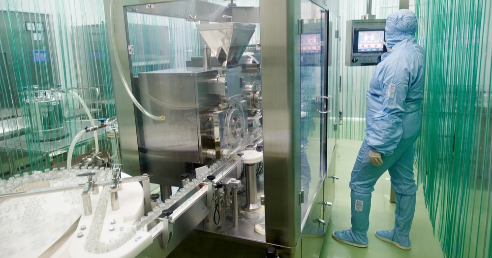 Operator-working-in-a-sterile-good-aseptic-practices-GMP-cleanroom