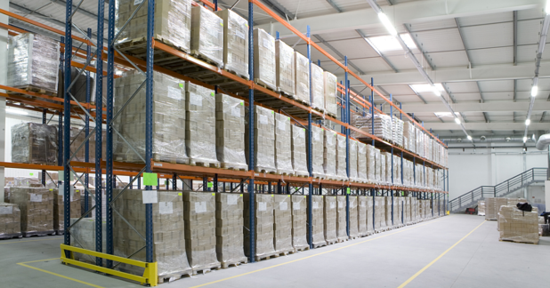 GMP warehouse with pharmaceutical materials in storage on racks
