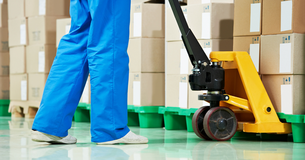 GMP Operator working pallet trolley in a GMP warehouse