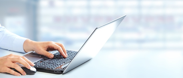 woman-using-laptop-and-mouse