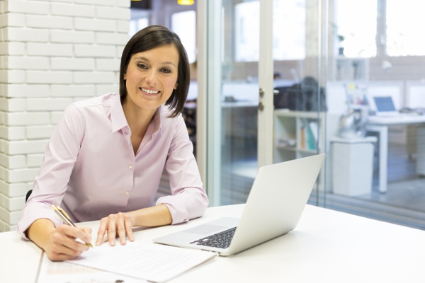 Quality-Assurance-Manager-Working-at-Desk