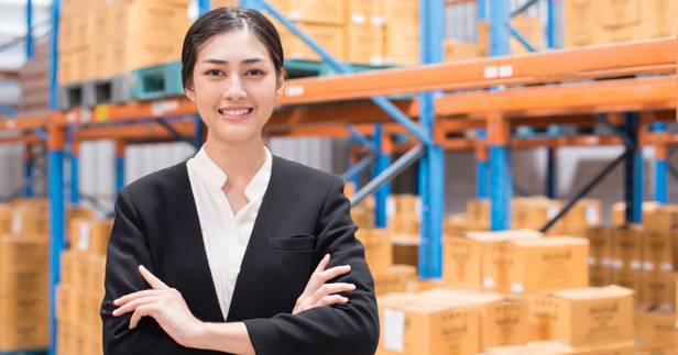 Happy Asian Woman in Warehouse